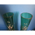 a pair of early 20th century German enemalled green glass vases