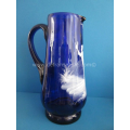 an antique blue Mary Gregor blue glass jug