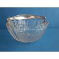 an antique crystal bonbon dish with silver handle