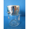 a crystal scent bottle with silver top