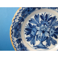 a pair of 18th century earthenware Delft plates