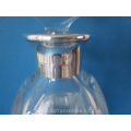 a crystal Orrefors decanter with silver mounting