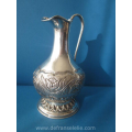 an antique French silver water pitcher