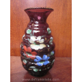 an antique hand painted purple glass vase