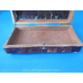 an antique tortoiseshell spoon box
