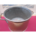 a vintage copper pan with lid