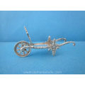a vintage Dutch silver miniature wheelbarrow