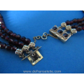 an antique three strand garnet necklace with 14ct gold closure