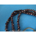 an antique three strand garnet bracelet with 14ct gold closure