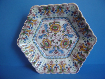an earthenware hand painted polychrome Makkum dish