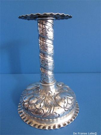 an antique sterling silver candlestick