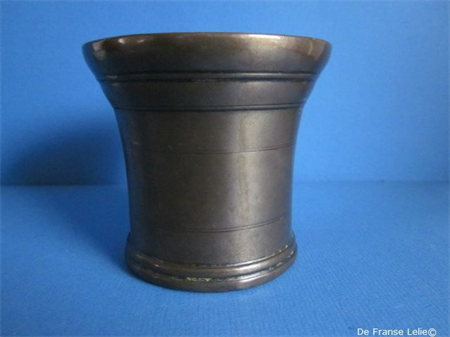 an antique bronze mortar