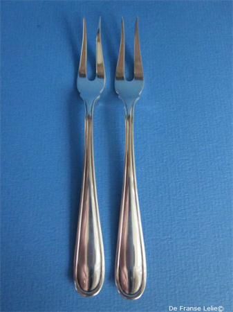 a pair of vintage Dutch silver meat forks