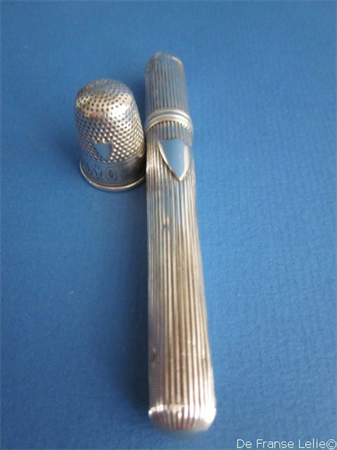 an antique Dutch silver timble including matching silver needle case holder
