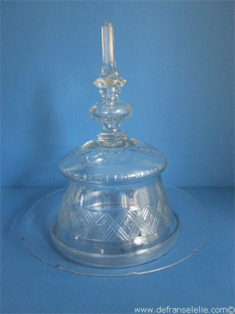 an antique crystal cut cheese dome dish