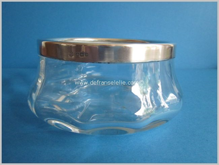 a clear crystal glass bowl with silver mountings