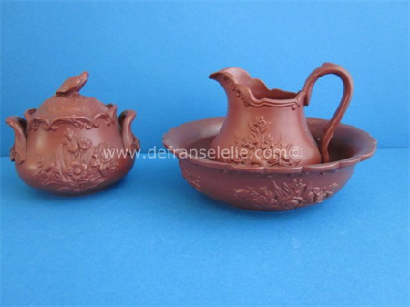 an antique red earthenware milk jug