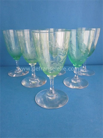 a set of six antique green crystal wine glasses