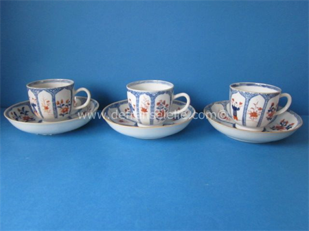 three antique Chinese imari cups and saucers, decorated with boys