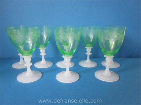 a set of eight etched antique green crystal wine glasses