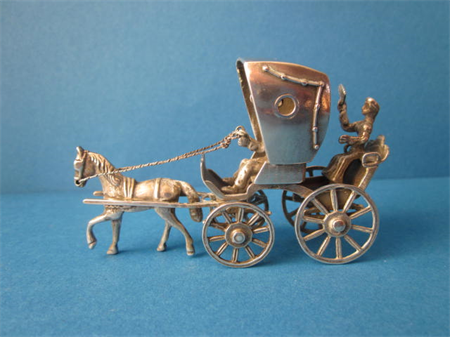 a vintage Dutch silver horse carriage