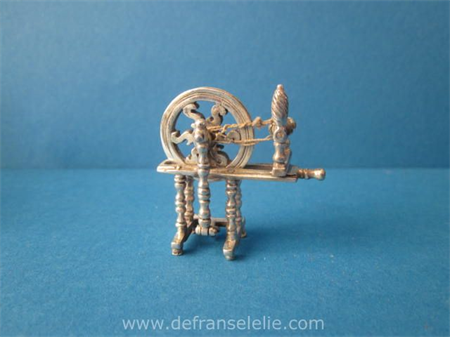 a vintage sterling silver miniature spinning wheel