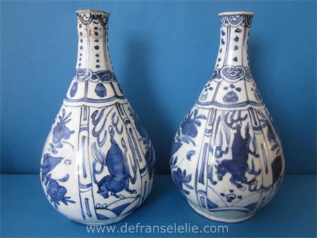 a pair of antique Chinese porcelain Wanli bottles with the running horses decoration