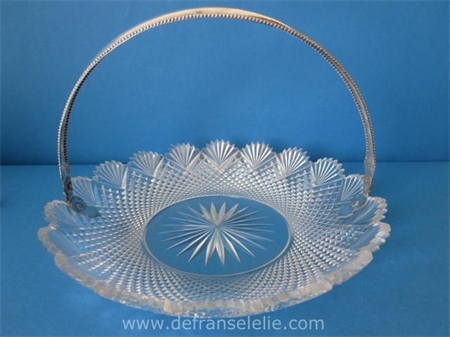 an antique crystal biscuit dish with silver handle