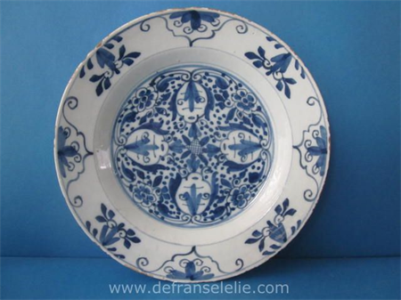 an 18th century Dutch Delft earthenware charger