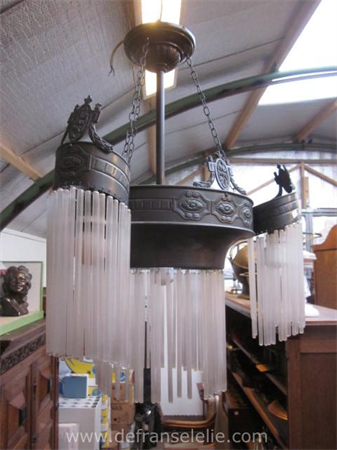 an art deco patinated brass hanging lamp with glass tubes