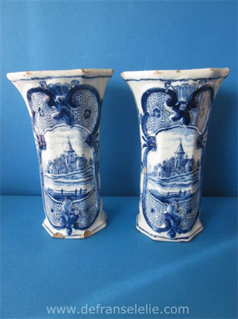 a pair of 18th century Dutch Delft vases, marked LPK (Lampetkan)