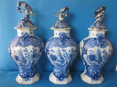 a set of three 18th century Dutch Delft earthenware vases