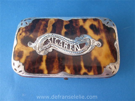 an antique mother of pearl cigar case