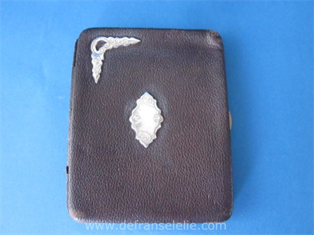 an antique leather cigar case