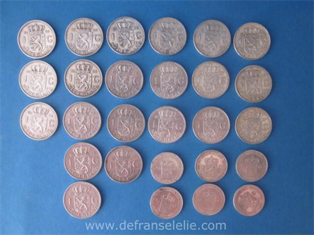 a small collection of Dutch silver coins 21 guilders and half guilders
