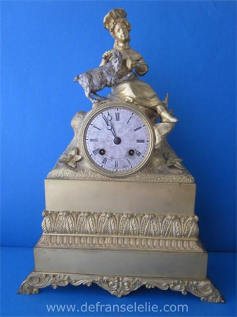 an antique French gilt bronze mantle clock