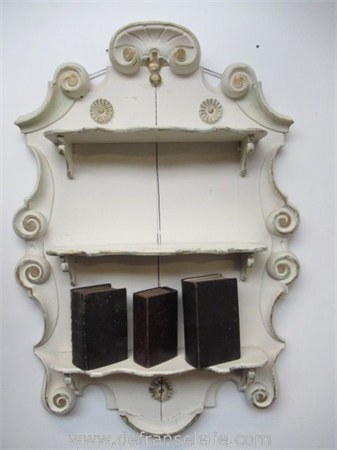 an antique painted mahogany wall console