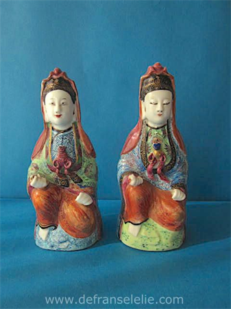 a pair of antique Chinese polychrom porcelain quanyins