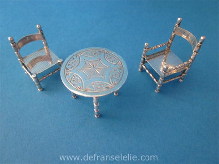 a vintage Dutch silver miniature table including chairs