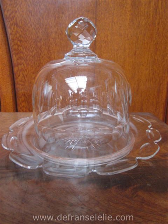 an antique crystal cheese dome dish