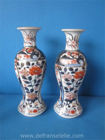 a pair of early 18th century Japanese imari vases