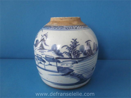 an antique Chinese blue and white ginger jar with a river landscape