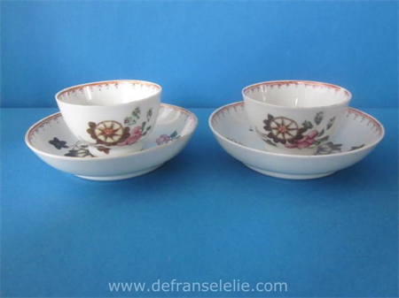 a pair of antique Lowestoft porcelain cups and saucers