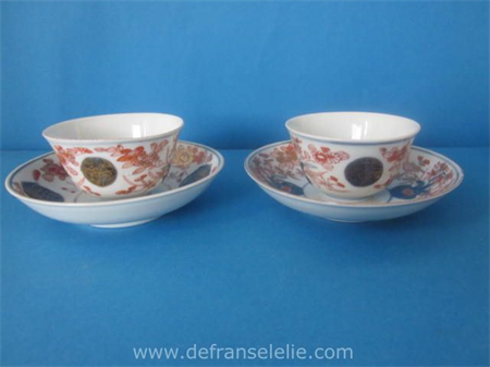 a pair of 18th century Japanese imari porcelain cups and saucers