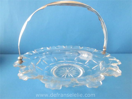 an antique cut crystal biscuit dish with silver handle