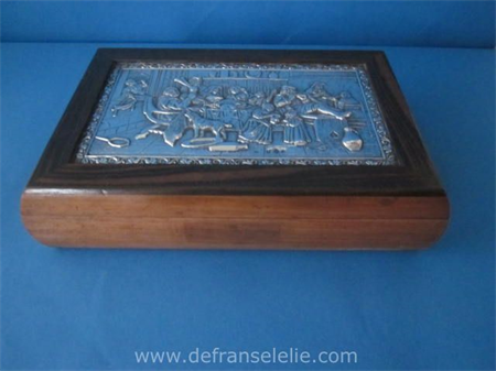 a vintage wooden cigar box with silver inlay