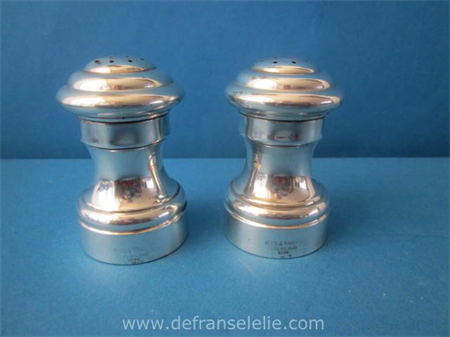 a pair of sterling silver pepper and salt shakers