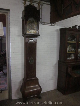 an 18th century Dutch walnut longcase clock