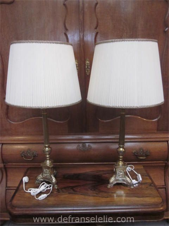 a pair of vintage brass candlesticks style table lamps