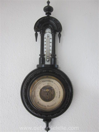 an antique ebonised wooden barometer